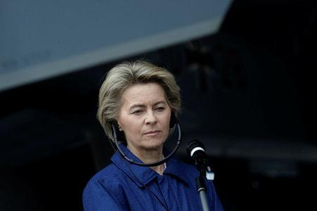 German Defence minister Ursula von der Leyen listens to media in Amari air base