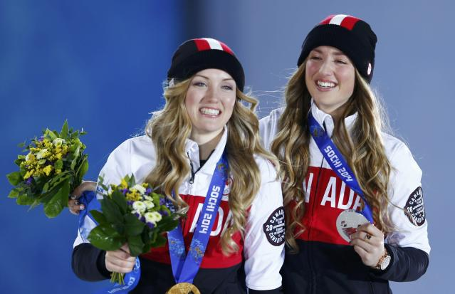 Gold medalist Justine Dufour-Lapointe of Canada and her compatriot, silver medalist Chloe Dufour-Lapointe (R), pose during the medal ceremony for the women's freestyle skiing moguls at the Sochi 2014 Sochi Winter Olympics, February 9, 2014. REUTERS/Shamil Zhumatov (RUSSIA - Tags: SPORT SKIING OLYMPICS)