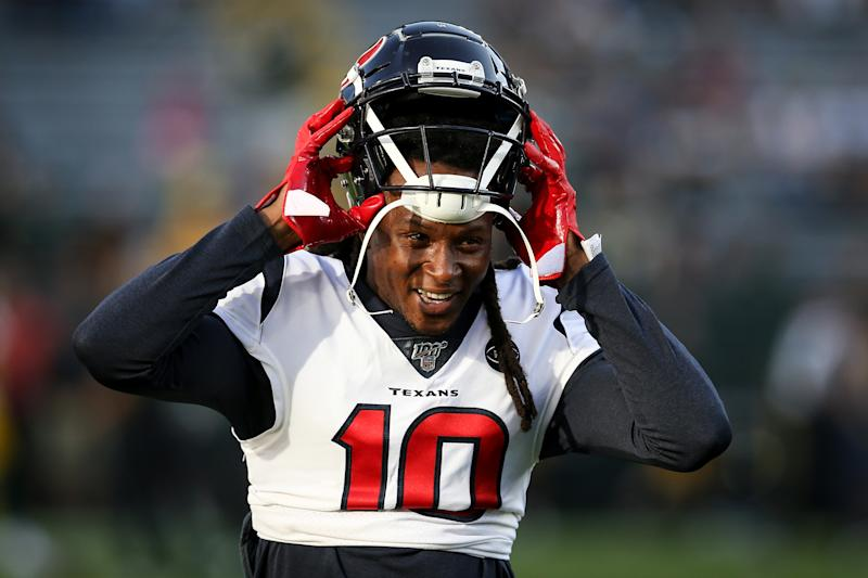 DeAndre Hopkins puts on his helmet as a member of the Texans.