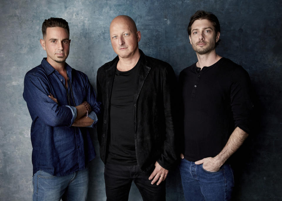 """FILE - In this Jan. 24, 2019, file photo, Wade Robson, from left, director Dan Reed and James Safechuck pose for a portrait to promote the film """"Leaving Neverland"""" during the Sundance Film Festival in Park City, Utah. (Photo by Taylor Jewell/Invision/AP, File)"""
