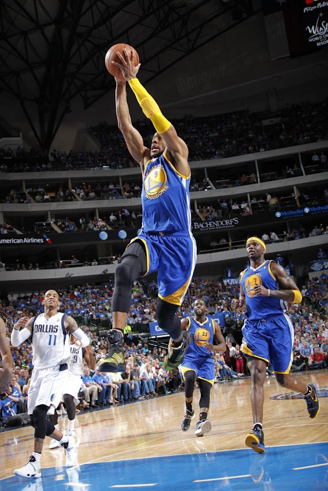 DALLAS, TX - APRIL 1: Andre Iguodala #9 of the Golden State Warriors dunks against the Dallas Mavericks on April 1, 2014 at the American Airlines Center in Dallas, Texas. (Photo by Glenn James/NBAE via Getty Images)