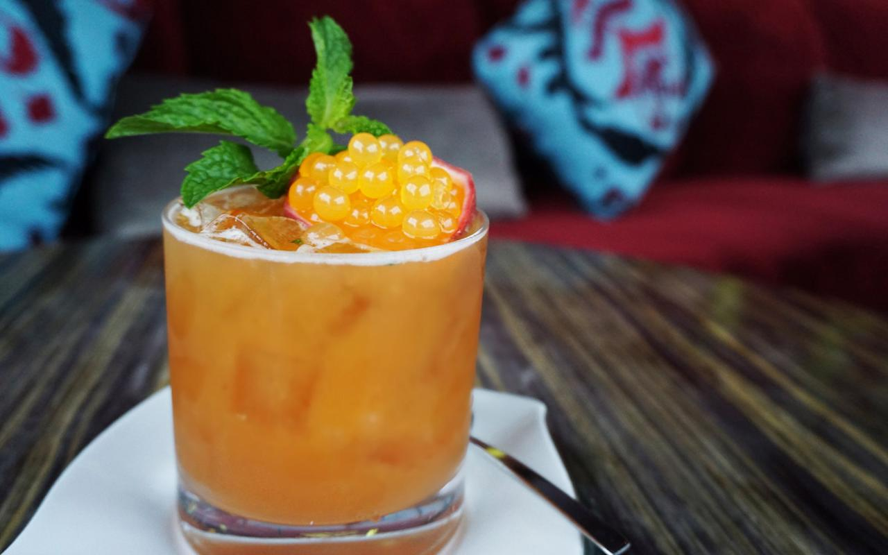 """<p><em>""""An Aquarius loves to have a sense of independence. In 'Lovers Potion', we combined the independent, distinctive flavors of passion fruit and pumpkin to make a delicious cocktail.""""</em></p>  <p><strong>Ingredients</strong></p>  <p>1.5 oz passion fruit puree </p>  <p>1 oz pumpkin juice infused with pepper </p>  <p>.5 oz POM juice </p>  <p>.75 oz cranberry/cinnamon syrup </p>  <p>2 oz pear green tea</p>  <p>Mint sprig</p>  <p>Passion fruit caviar pearls</p>  <p><strong>How-To</strong></p>  <p>Combine all ingredients in a glass</p>  <p>Top with elderflower tonic</p>  <p>Garnish with passion fruit caviar pearls & mint sprig</p>"""