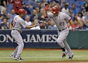 Los Angeles Angels' Mike Trout, right, celebrates with third base coach Dino Ebel after his fourth-inning home run off Tampa Bay Rays starting pitcher Roberto Hernandez during a baseball game Tuesday, Aug. 27, 2013, in St. Petersburg, Fla. (AP Photo/Chris O'Meara)