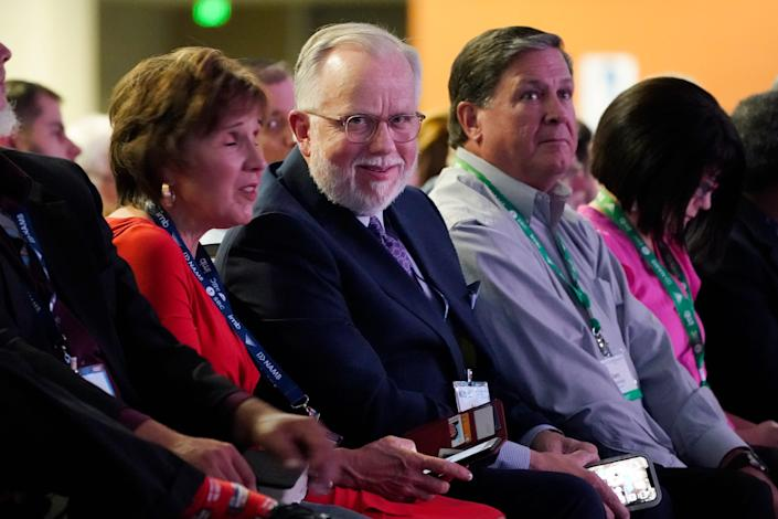 Pastor Ed Litton, center, of Saraland, Ala., attends the annual Southern Baptist Convention meeting Tuesday, June 15, 2021, in Nashville, Tenn. (AP Photo/Mark Humphrey)