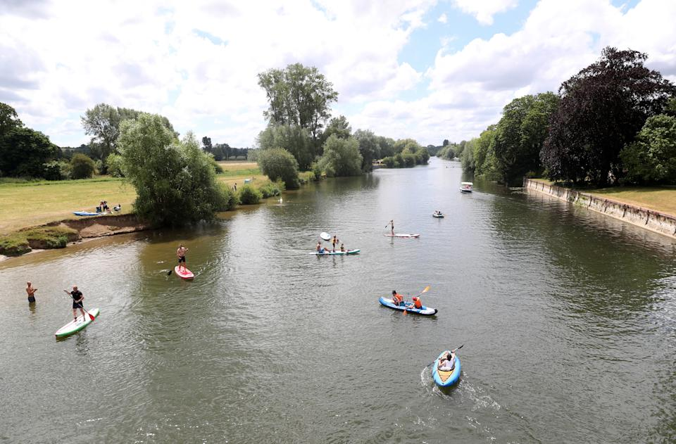 WALLINGFORD, ENGLAND - JUNE 13: Members of the public Kayak and paddle board on the River Thames as they enjoy the warm weather on June 13, 2020 in Wallingford, England .As the British government further relaxes Covid-19 lockdown measures in England, this week sees preparations being made to open non-essential stores and Transport for London handing out face masks to commuters. International travelers arriving in the UK will face a 14-day quarantine period. (Photo by Catherine Ivill/Getty Images)
