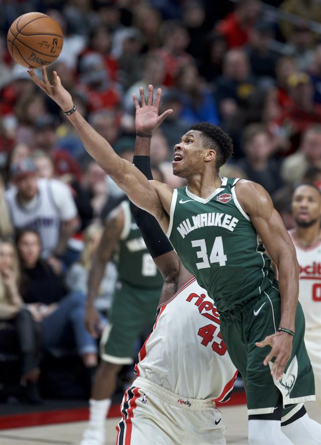 Milwaukee Bucks forward Giannis Antetokounmpo (34) shoots over Portland Trail Blazers forward Anthony Tolliver during the second half of an NBA basketball game in Portland, Ore., Saturday, Jan. 11, 2020. (AP Photo/Craig Mitchelldyer)