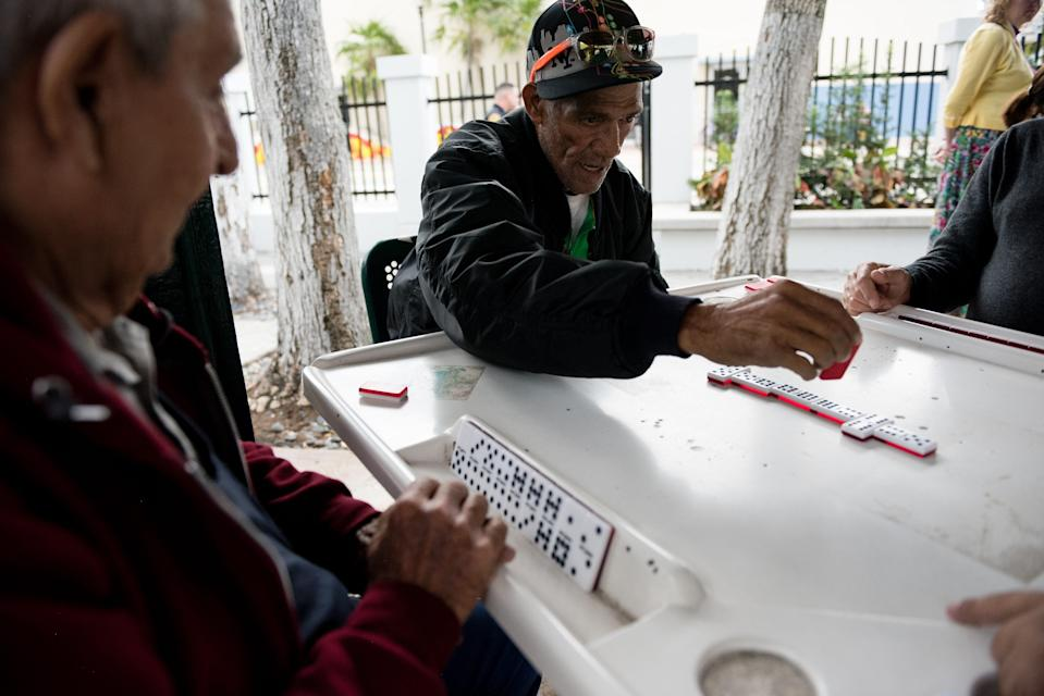 "Little Havana locals play dominoes in historic Domino Park, ""a great gathering place for older Cubans,"" a Miami historian says."