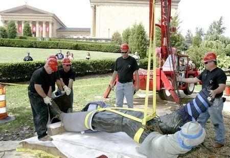"Workers prepare to lift the ""Rocky"" statue to place it near the Philadelphia Museum of Art in Philadelphia"