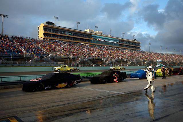 HOMESTEAD, FL - NOVEMBER 20: A crew member walks down pit road as rain falls during a red flag rain delay during the NASCAR Sprint Cup Series Ford 400 at Homestead-Miami Speedway on November 20, 2011 in Homestead, Florida. (Photo by Chris Graythen/Getty Images)