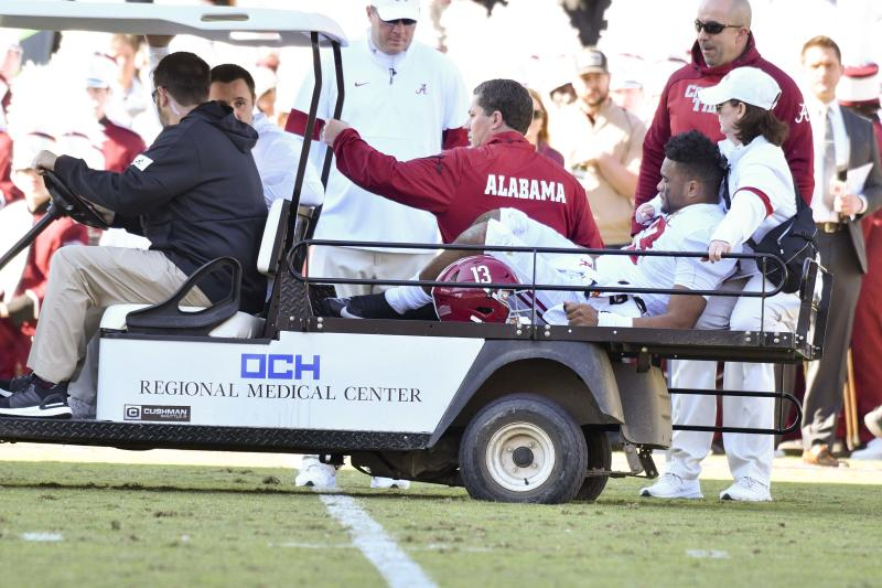 Alabama Crimson Tide quarterback Tua Tagovailoa (13) is carted off the field due to an injury. (USA Today)