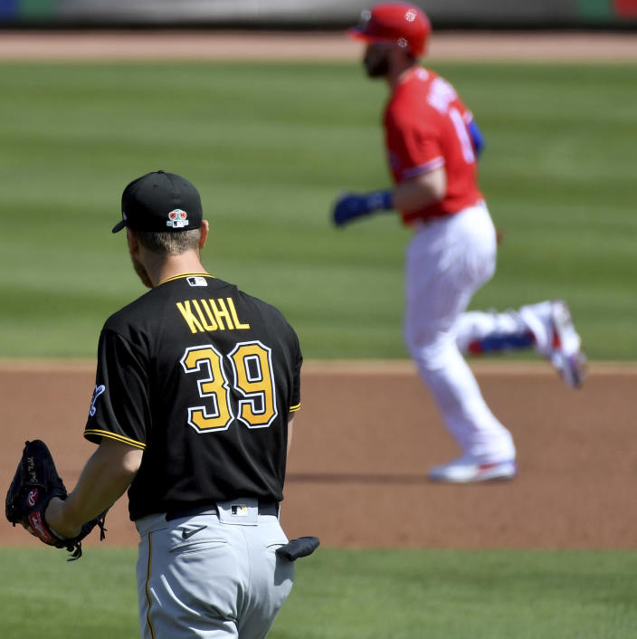 Philadelphia Phillies designated hitter Bryce Harper rounds the bases after hitting a home run off Pittsburgh Pirates pitcher Chad Kuhl in the first inning of a spring training baseball game, Friday, March 5, 2021, at Baycare Ballpark in Clearwater, Fla. (Matt Freed/Pittsburgh Post-Gazette via AP)