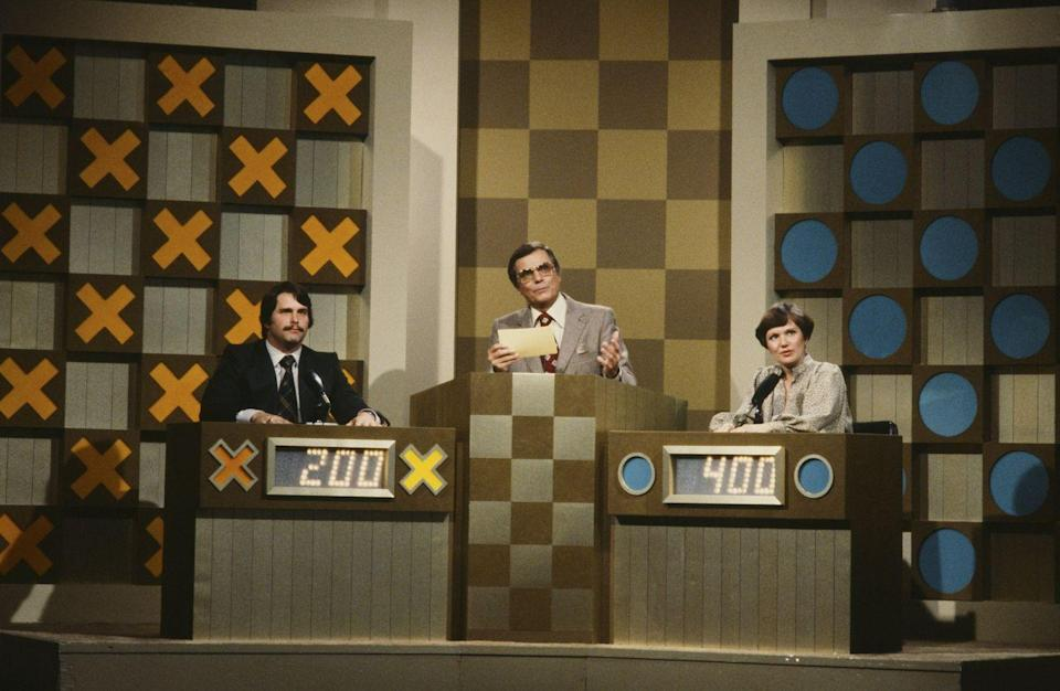 <p>The original version of <em>Hollywood Squares, </em>AKA trivia tic tac toe, started airing in 1966. Peter Marshall was the original host and held the post until 1981. Marshall got his start as part of a comedy duo in the '50s. He came back to the show in 2002 as a panelist when Tom Bergeron was the host.</p>