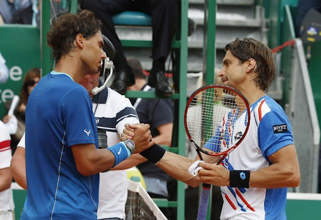 Rafael Nadal of Spain, left, and David Ferrer of Spain, right, shake hands after their quarterfinals match of the Monte Carlo Tennis Masters tournament in Monaco, Friday, April 18, 2014. Ferrer won 7-6 6-4. (AP Photo/Michel Euler)