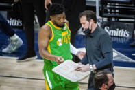 Utah Jazz guard Donovan Mitchell (45) talks with coach Quin Snyder during a timeout in the first half of the team's NBA basketball game against the Portland Trail Blazers on Thursday, April 8, 2021, in Salt Lake City. (AP Photo/Isaac Hale)