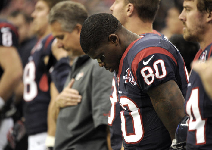 Houston Texans wide receiver Andre Johnson (80) bows his head before an NFL football game against the Indianapolis Colts Sunday, Dec. 16, 2012, in Houston. (AP Photo/Dave Einsel)