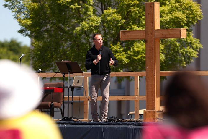 Scott Sheppard, pastor of Cornerstone Church, preaches at an outdoor service n Athens, Ga., on April 26.