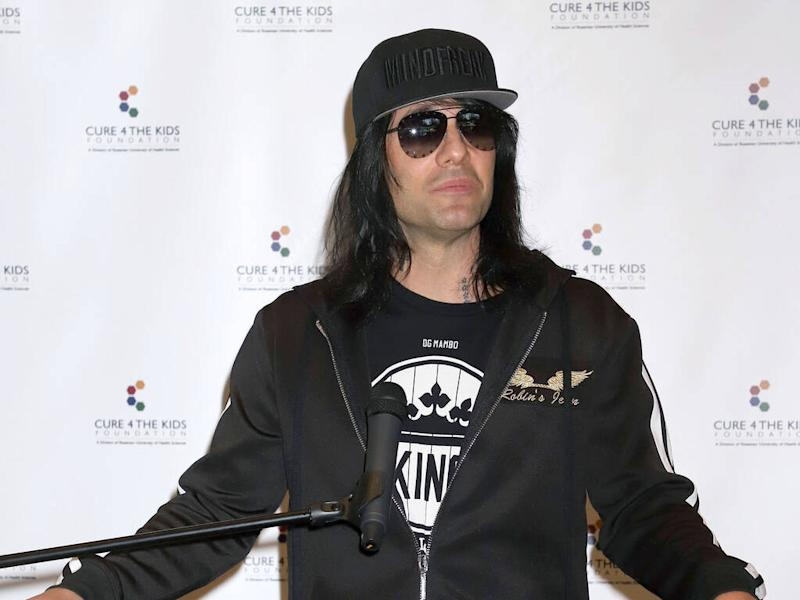 Criss Angel shaves son's head amid ongoing cancer battle