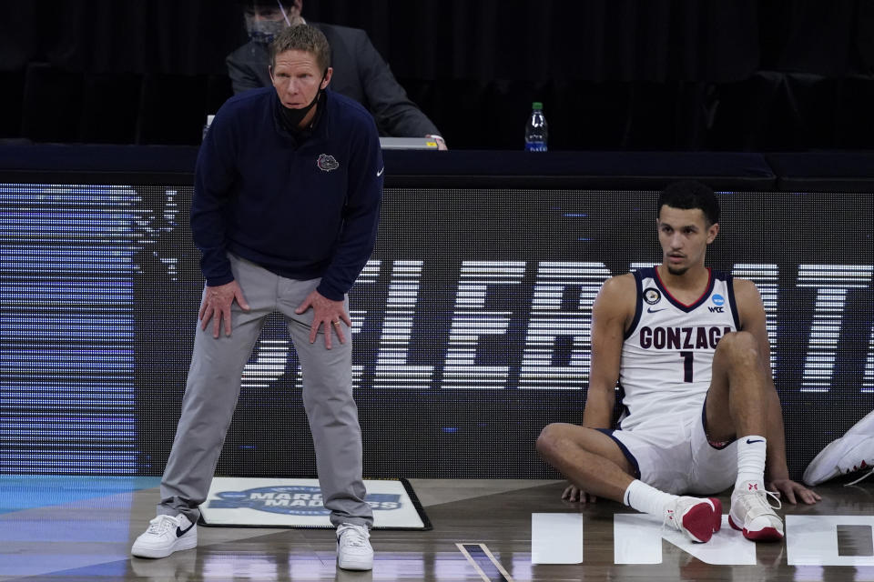 Gonzaga head coach Mark Few and guard Jalen Suggs (1) watch from the sideline during the second half of an Elite 8 game against Southern California in the NCAA men's college basketball tournament at Lucas Oil Stadium, Tuesday, March 30, 2021, in Indianapolis. (AP Photo/Darron Cummings)