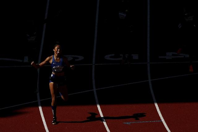 Allyson Felix crosses the finish line to place first in the 400m final during the 2016 US Olympic Track & Field Team Trials, in Eugene, Oregon, on July 3 (AFP Photo/Patrick Smith)