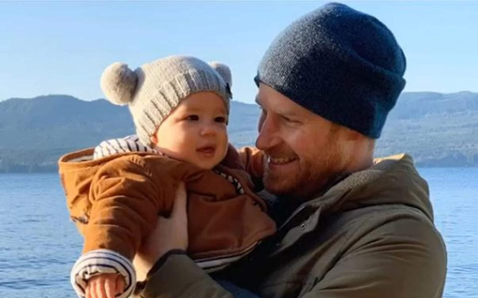 The Duke of Sussex holds his son son Archie Mountbatten-Windsor - PA