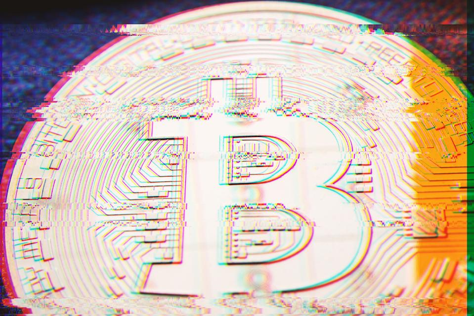 closeup of golden bitcoin coin with digital pixel glitch error effect and silver and yellow reflection on its surface, scam or hacker attack concept in cryptocurrencies