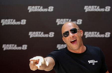 "FILE PHOTO: Actor Vin Diesel reacts as he poses during a photocall to promote his film ""Fast & Furious 8"" in Madrid"