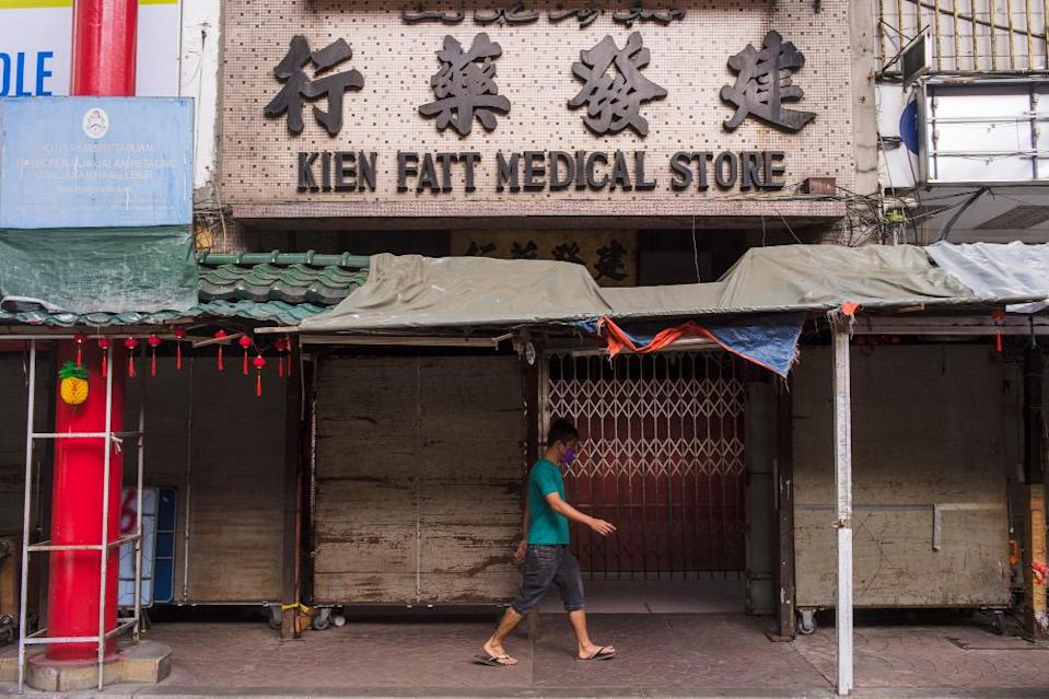This traditional Chinese medicine shop in Petaling Street was closed, while most of the stalls and shops along the street were also closed. — Picture by Shafwan Zaidon