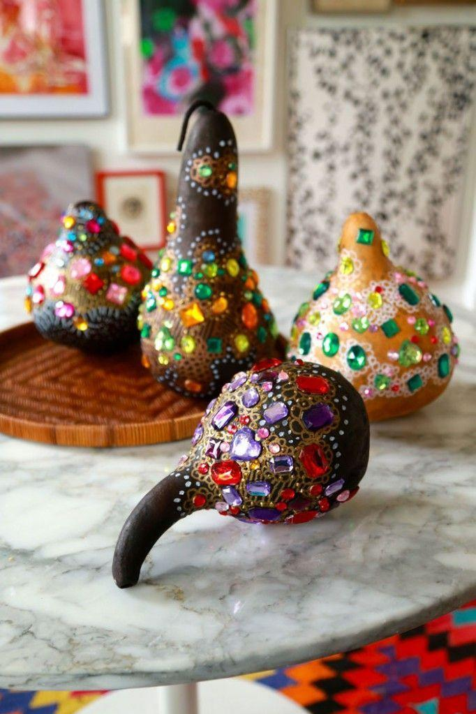 """<p>Make real or artificial gourds look centerpiece-worthy by embellishing them with rhinestones in different colors and sizes. </p><p><em><a href=""""http://www.auntpeaches.com/2014/10/pimp-my-gourd.html"""" rel=""""nofollow noopener"""" target=""""_blank"""" data-ylk=""""slk:Get the tutorial at Aunt Peaches »"""" class=""""link rapid-noclick-resp"""">Get the tutorial at Aunt Peaches »</a></em></p>"""