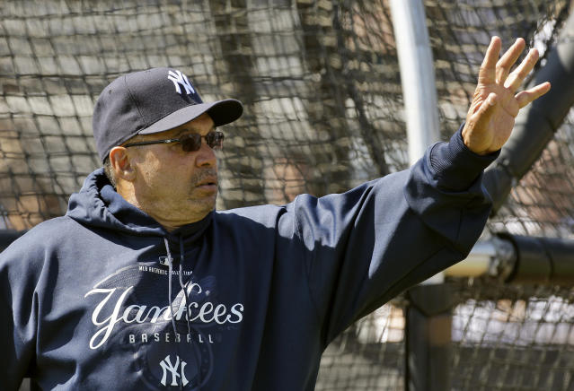 Former New York Yankees great Reggie Jackson waves to fans as he watches during practice Tuesday Feb. 24, 2009 in Tampa, Fla. (AP)