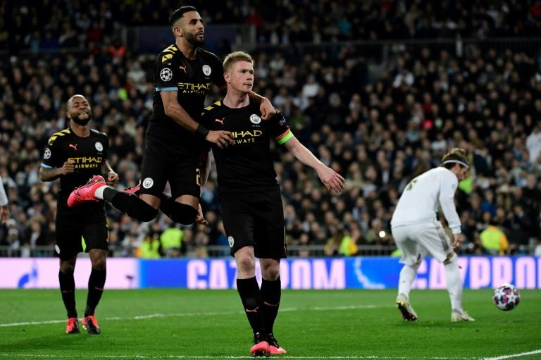 Kevin de Bruyne (right) celebrates scoring a winning penalty as Manchester City beat Real Madrid 2-1 on Wednesday at the Santiago Bernabeu