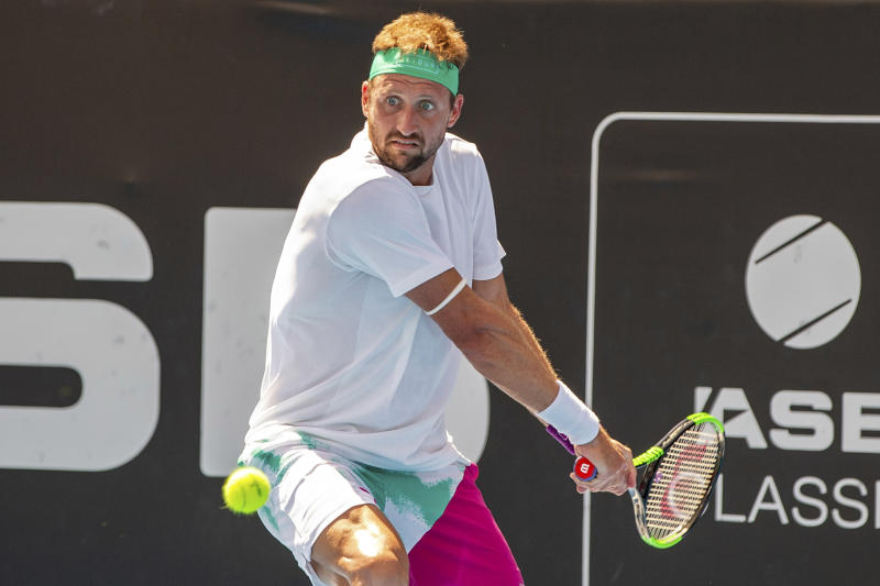 Tennys Sandgren of the U.S. plays a shot against Britain's Cameron Norrie during their singles final match in the ASB Classic at ASB Tennis Arena in Auckland, New Zealand, Saturday, Jan. 12, 2019. (AP Photo/David Rowland)
