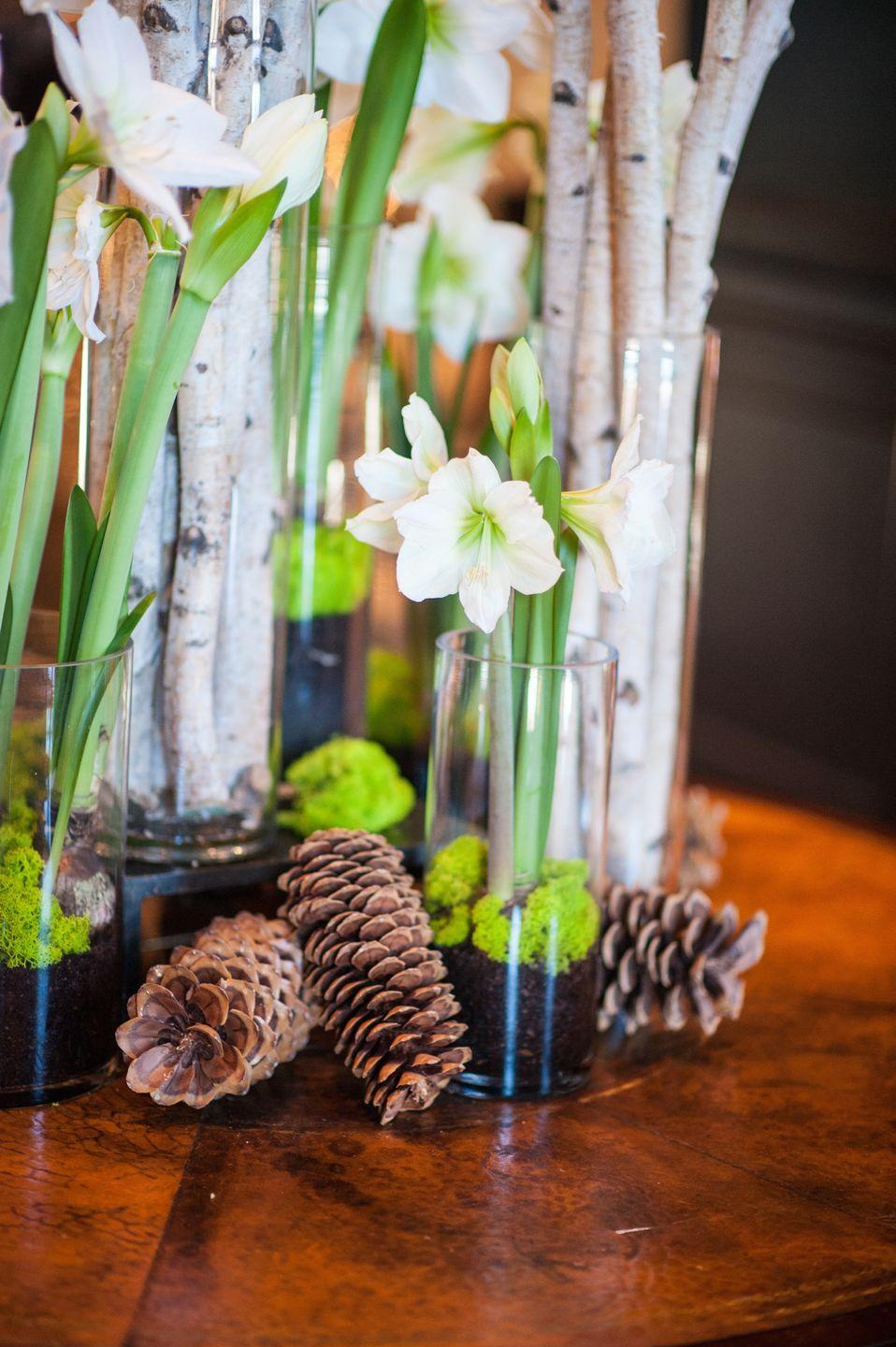 "<p>While you may not actually make it outside for, say, a sleigh ride through the frosted woods, you can still include the outdoor charms of the season in your centerpiece. Arrange classic white flowers in vases, but cushion with strewn pinecones and separate vases filled with sticks and branches. </p><p><em>Via </em><em><a href=""http://www.decorationinc.com"" rel=""nofollow noopener"" target=""_blank"" data-ylk=""slk:Decoration Inc."" class=""link rapid-noclick-resp"">Decoration Inc.</a></em></p>"