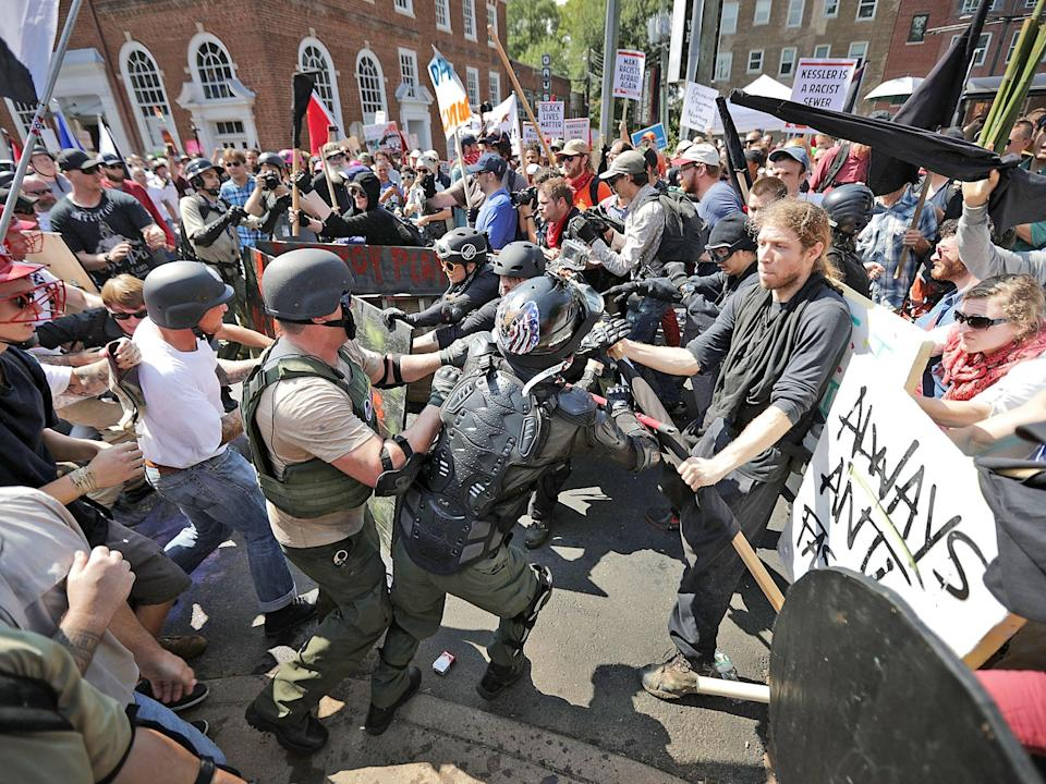 Pressure grew on tech firms to stop giving hate a platform after revulsion at far-right demonstrations in Charlottesville over the weekend: Getty