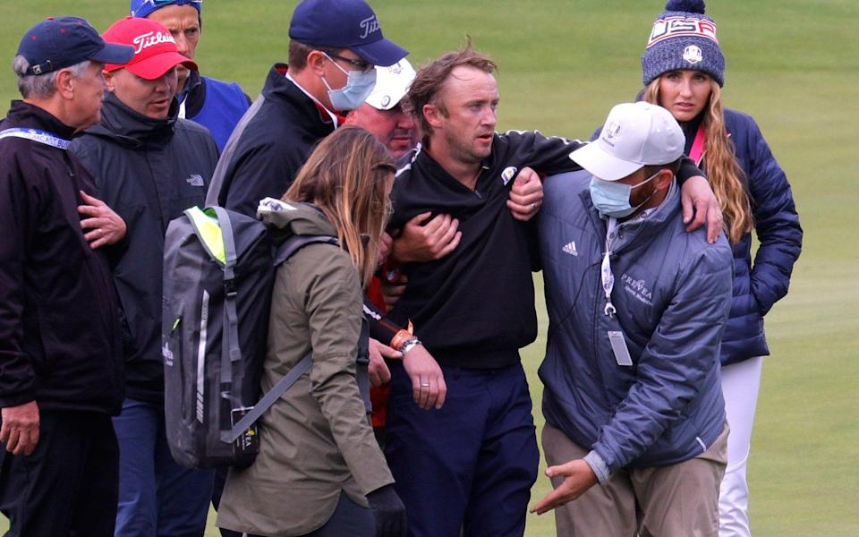 Tom Felton is helped up after being taken ill - REUTERS