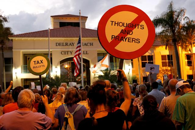 <p>Protesters take part in a Call To Action Against Gun Violence rally by the Interfaith Justice League and others in Delray Beach, Fla., Feb. 19, 2018. (Photo: Joe Skipper/Reuters) </p>