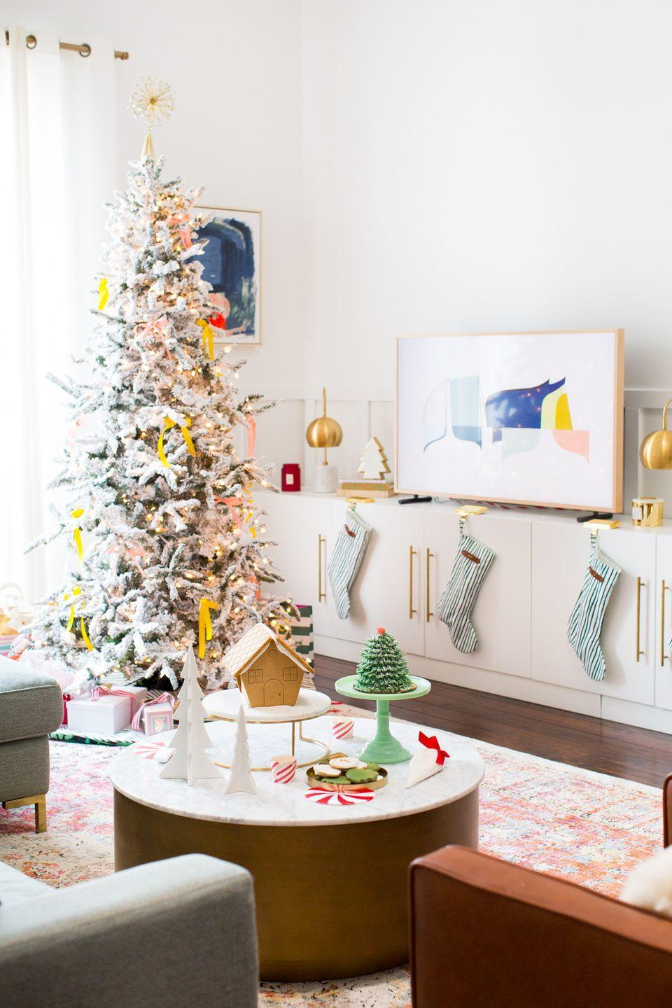 "<p>Skip the tree full of ornaments and opt for a simple frosted white tree with a garland instead. You'll have your Christmas decorating done in seconds with this one!</p><p>See more at <a href=""https://sugarandcloth.com/how-we-decorated-our-home-for-christmas/"" rel=""nofollow noopener"" target=""_blank"" data-ylk=""slk:Sugar & Cloth"" class=""link rapid-noclick-resp"">Sugar & Cloth</a>.</p><p><a class=""link rapid-noclick-resp"" href=""https://go.redirectingat.com?id=74968X1596630&url=https%3A%2F%2Fwww.wayfair.com%2Fholiday-decor%2Fpdp%2Fnational-tree-co-winchester-pine-7-white-artificial-christmas-tree-with-450-clear-lights-and-stand-ntc2177.html&sref=https%3A%2F%2Fwww.housebeautiful.com%2Fentertaining%2Fholidays-celebrations%2Ftips%2Fg505%2Fchristmas-tree-decoration-ideas-pictures-1208%2F"" rel=""nofollow noopener"" target=""_blank"" data-ylk=""slk:SHOP TREES"">SHOP TREES</a><em><strong> White Tree, $180</strong></em></p>"