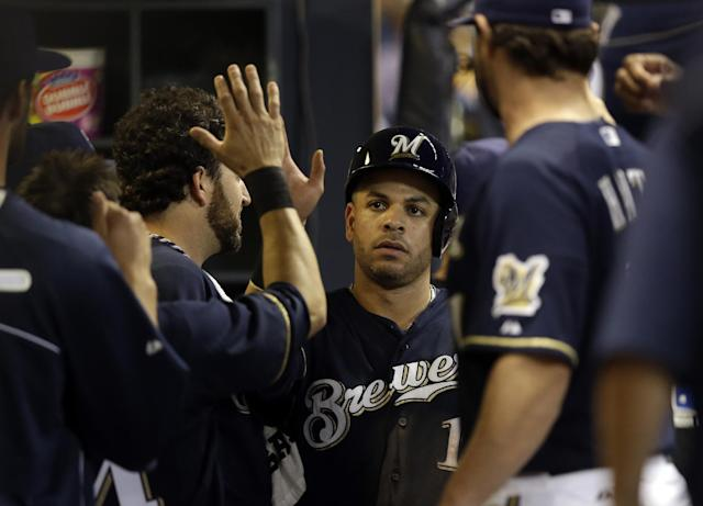 Milwaukee Brewers' Aramis Ramirez is congratulated in the dugout after scoring during the eighth inning of a baseball game against the Pittsburgh Pirates, Wednesday, Sept. 4, 2013, in Milwaukee. Ramirez scored on a hit by Martin Maldonado. (AP Photo/Morry Gash)