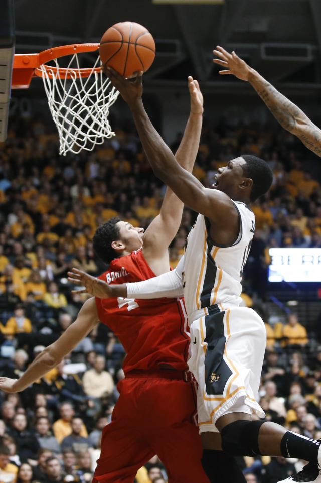 Wichita State's Cleanthony Early shoots over Bradley's Austin Barnes during the first half of an NCAA college basketball game Tuesday, Jan. 14, 2014, in Wichita, Kan. (AP Photo/Wichita Eagle, Jaime Green)