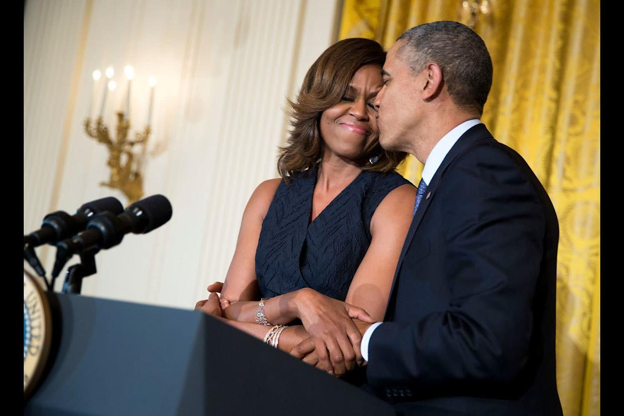 Michelle and Barack Obama at an Affordable Care Act reception in the East Room of the White House onMay 1, 2014.