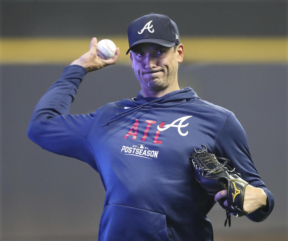 Atlanta Braves pithcher Charlie Morton, who is scheduled to start in Game 1 of the National League Division Series against the Milwaukee Brewers, throws during the baseball team's practice Thursday, Oct. 7, 2021, in Milwaukee. (Curtis Compton/Atlanta Journal-Constitution via AP)