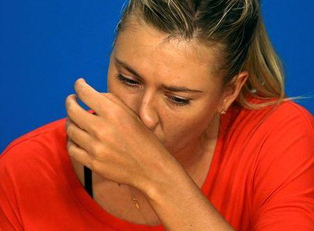 Russia's Sharapova reacts during a news conference after losing her quarter-final match against Williams of the U.S. at the Australian Open tennis tournament at Melbourne Park