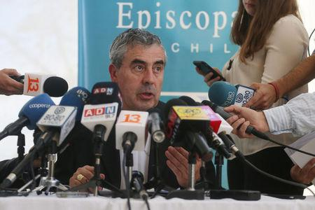 President of the Chilean Episcopal Conference, monsignor Santiago Silva, speaks to the media after receiving Pope Francis' letter stating, that the pope may summon Chile's bishops to Rome for a meeting on the country's sexual abuse crisis, in Punta de Tralca, Chile, April 11, 2018. REUTERS/Stringer