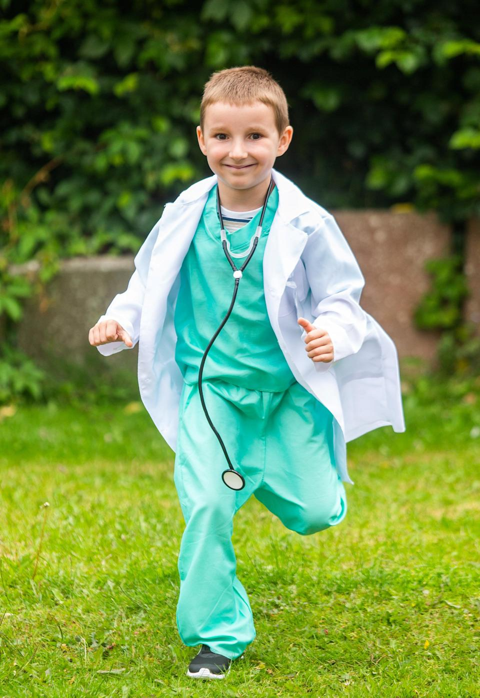 Ollie ran the last leg of his marathon as a doctor. (SWNS)