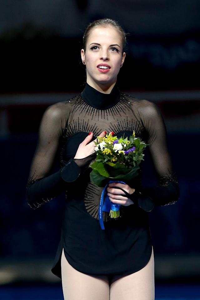 SOCHI, RUSSIA - FEBRUARY 20: Bronze medalist Carolina Kostner of Italy celebrates during the flower ceremony for the Ladies' Figure Skating on day 13 of the Sochi 2014 Winter Olympics at Iceberg Skating Palace on February 20, 2014 in Sochi, Russia. (Photo by Matthew Stockman/Getty Images)