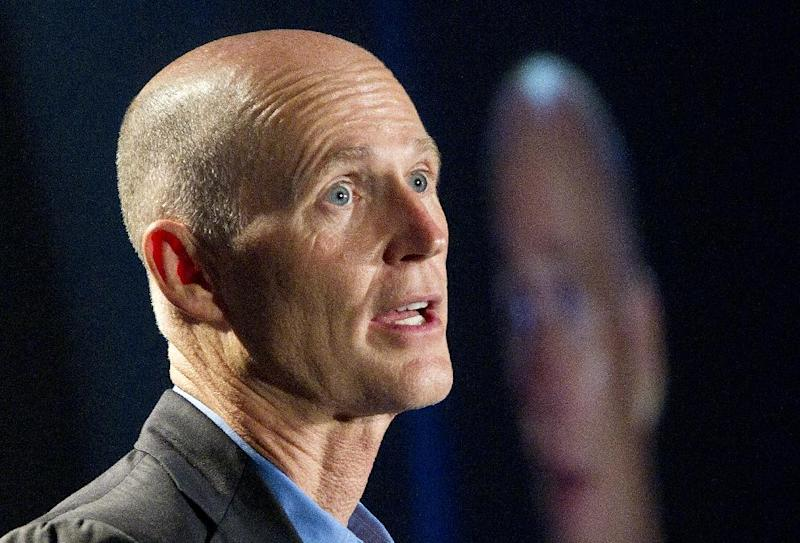"FILE - In this May 16, 2012 file photo, Florida Gov. Rick Scott speaks in Fort Lauderdale, Fla. From the South to the heartland, cracks are appearing in the once-solid wall of Republican resistance to President Barack Obama's health care law. Gov. Scott, one of the most visible opponents of Obama's overhaul, now says ""if I can get to yes, I want to get to yes.""  (AP Photo/J Pat Carter, File)"