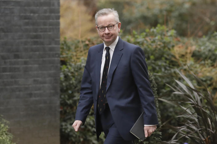 """FILE - In this file photo dated Thursday, Feb. 13, 2020, British lawmaker Michael Gove arrives at 10 Downing Street in London.  The British government is expected to water down plans for full border checks on goods coming from the European Union amid economic devastation caused by the coronavirus pandemic, according to new reports Friday June 12, 2020, Michael Gove, the minister in charge of Brexit preparations, will announce a more """"pragmatic and flexible"""" approach to imports.  (AP Photo/Matt Dunham, FILE)"""