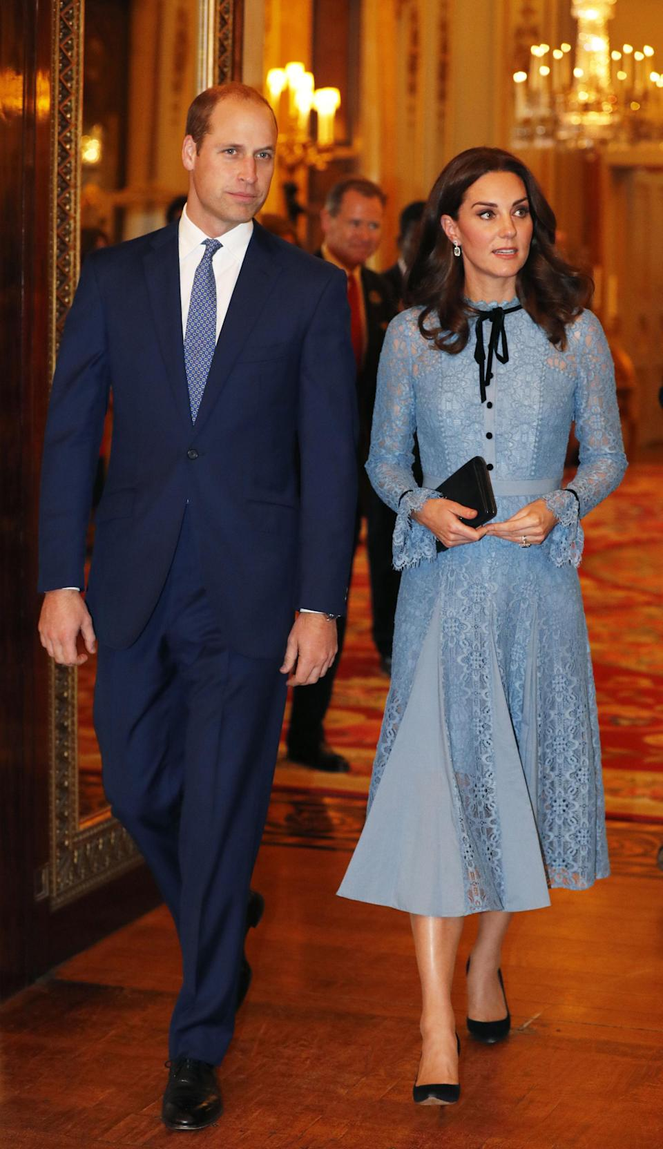 <p>The Duchess made her first public appearance after announcing that she was pregnant with her third child at Buckingham Palace on October 10. She opted for a blue lace dress by Temperley London known as the 'Eclipse' gown. <em>[Photo: Getty]</em> </p>