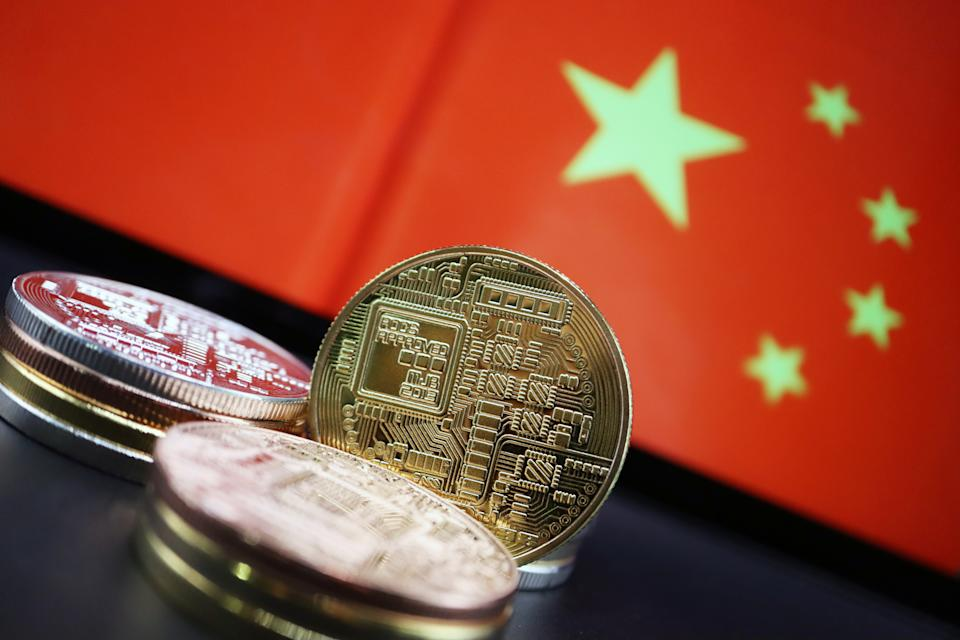 Cryptocurrency representations are seen in front of an image of the Chinese flag in this illustration picture taken June 2, 2021. REUTERS/Florence Lo/Illustration