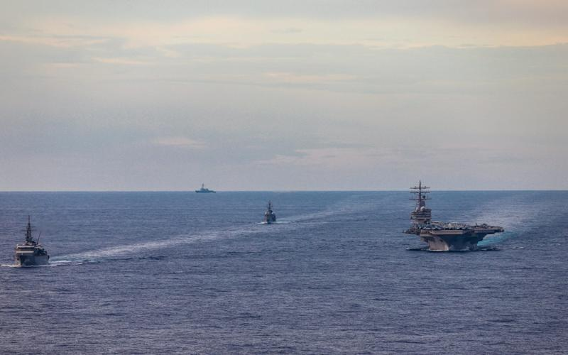Japan Maritime Self-Defense Force training ships conduct a passing exercise with Nimitz-class nuclear-powered aircraft carrier USS Ronald Reagan in the South China Sea - Reuters