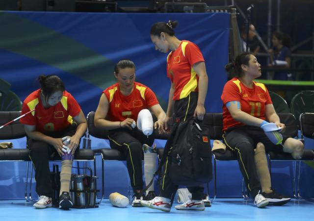 2016 Rio Paralympics - Sitting Volleyball - Final - Women's Gold Medal Match - Riocentro Pavilion 6 - Rio de Janeiro, Brazil, 17/09/2016. Players of team China after the match. REUTERS/Pilar Olivares FOR EDITORIAL USE ONLY. NOT FOR SALE FOR MARKETING OR ADVERTISING CAMPAIGNS.